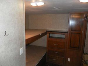Four single bed bunks and Jr. Dinette