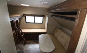 Private bunk room with three bunks, sofa bed and table