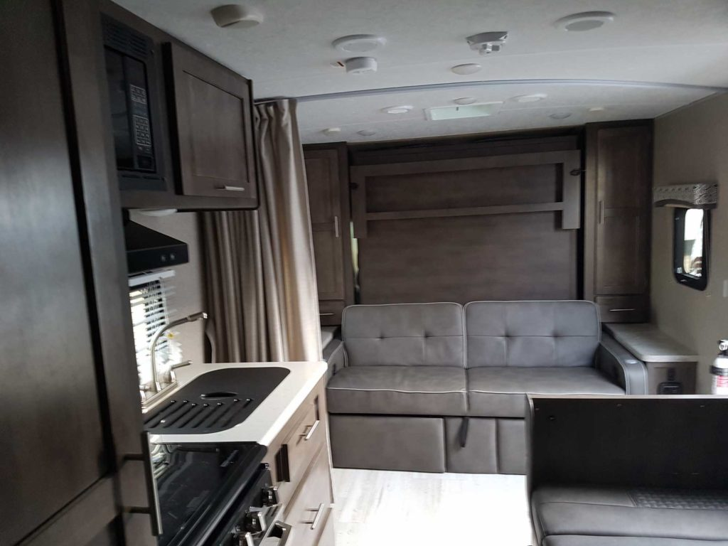Full kitchen, dinette and sofa couch