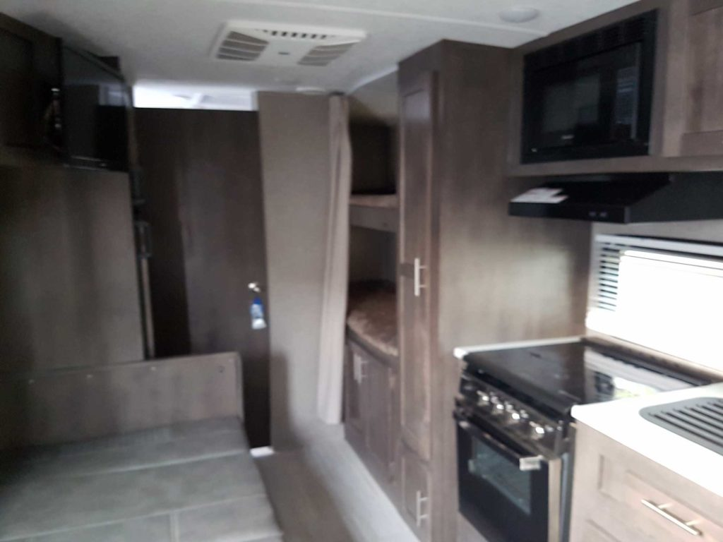 Convertible dinette, double bed bunks at rear