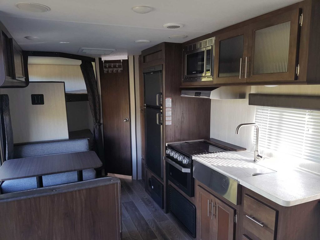Kitchen, dinette, double bed bunks at the rear